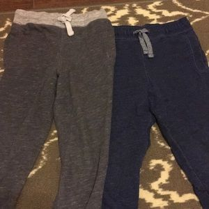 Two pairs of jogging pants.